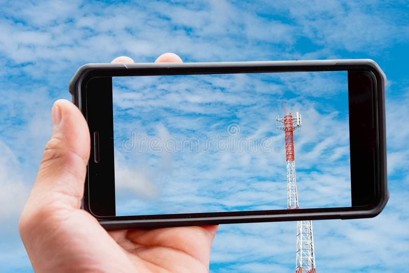 Mobile phone holder, horizontal. Mobile phone holder and The sky is the background and the antenna signals the phone. horizontal royalty free stock photo