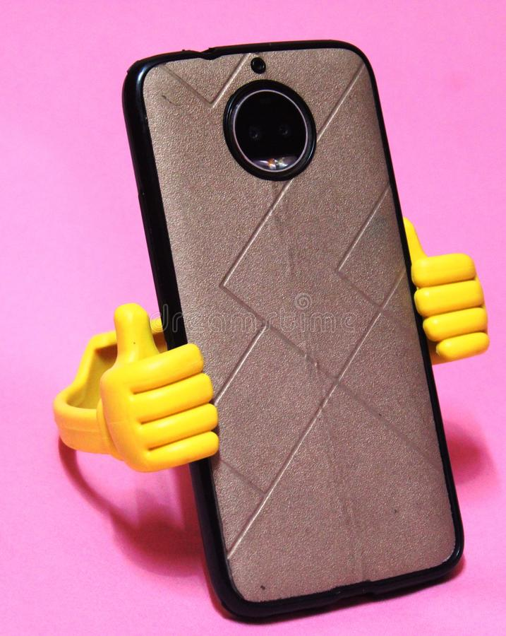 Mobile phone holders ,accessories hardware that is not integral to the operation of a mobile stock photos