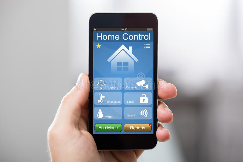 Mobile Phone With Home Control System On A Screen stock photos