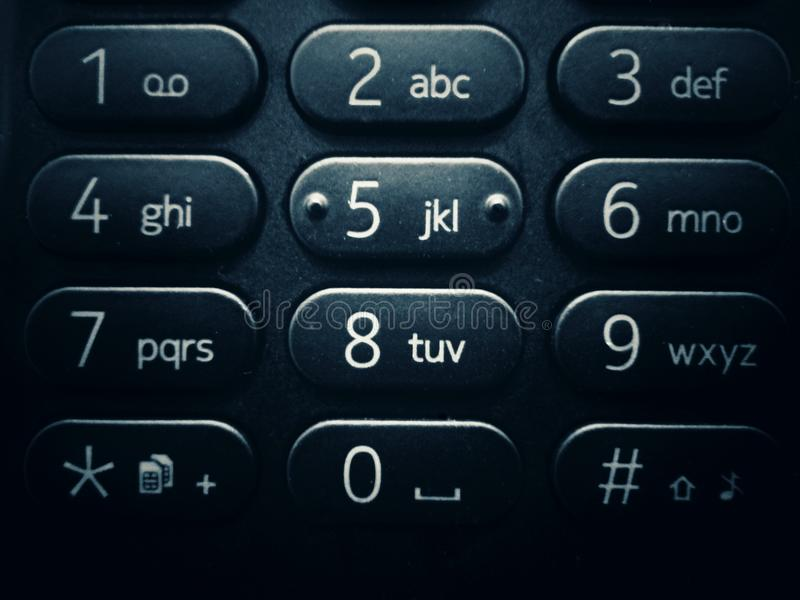 Mobile phone keyboard with numbers and letters - close-up royalty free stock photo