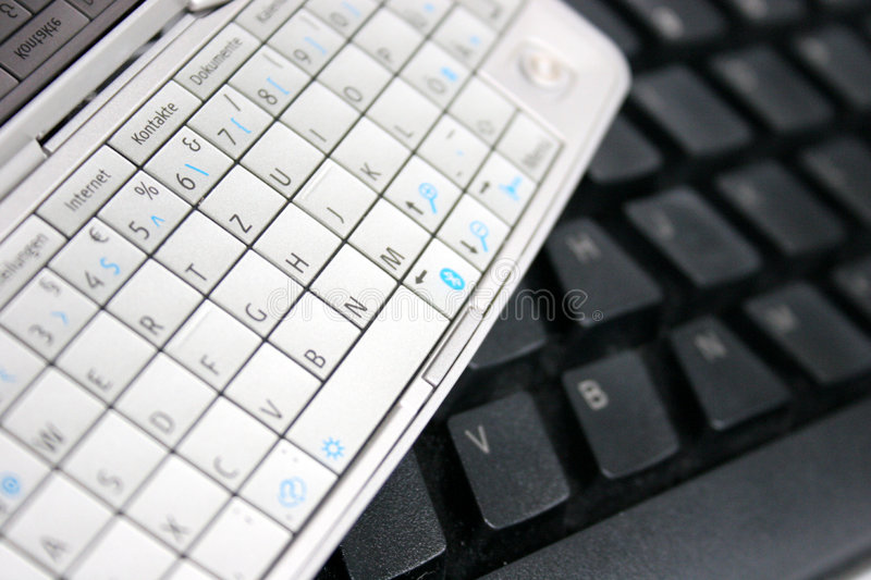 Mobile phone keypad and computer keyboard royalty free stock images