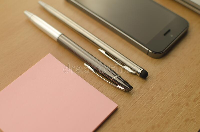Mobile phone and notes royalty free stock image