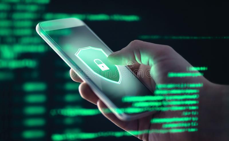 Mobile phone personal data and cyber security threat concept. Cellphone fraud. Smartphone hacked with illegal spyware. stock photos