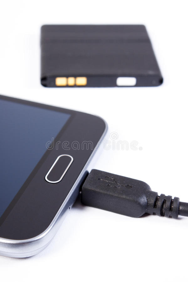 Mobile phone, plug of charger and telephone battery, smartphone charging royalty free stock photo