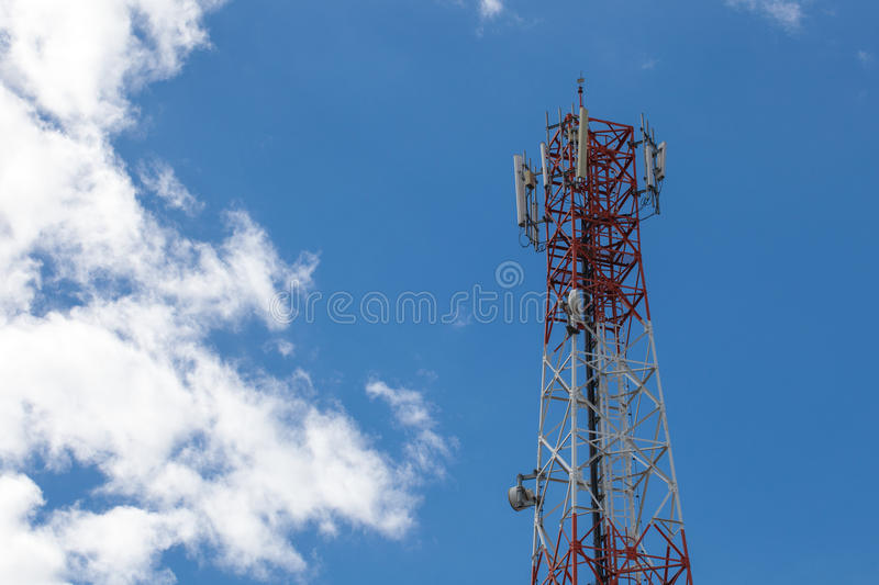 Mobile phone pole with blue sky and cloud.  stock image