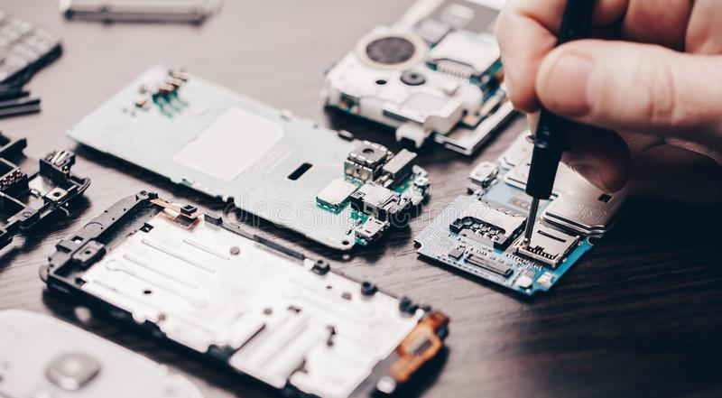 Mobile phone repair, hands closeup stock photo
