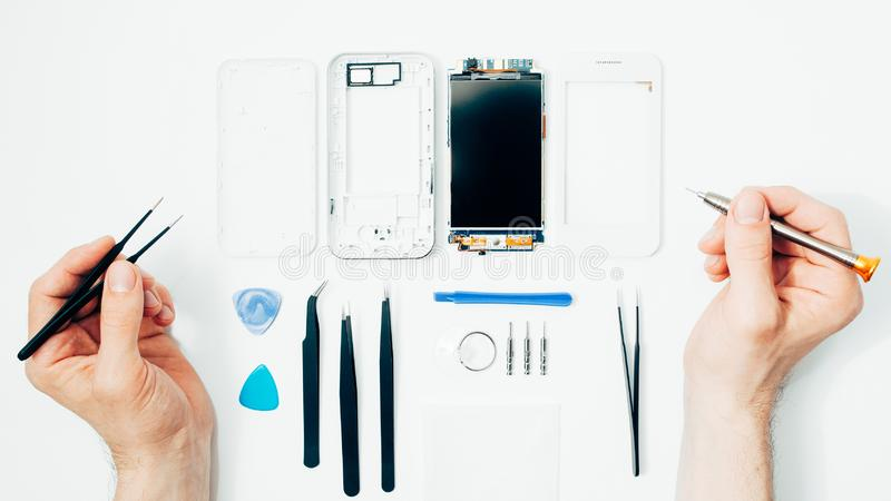 Mobile phone repair parts replacing broken screen stock image