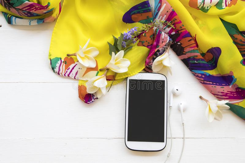 Mobile phone with scarf for lifestyle woman relax royalty free stock photography