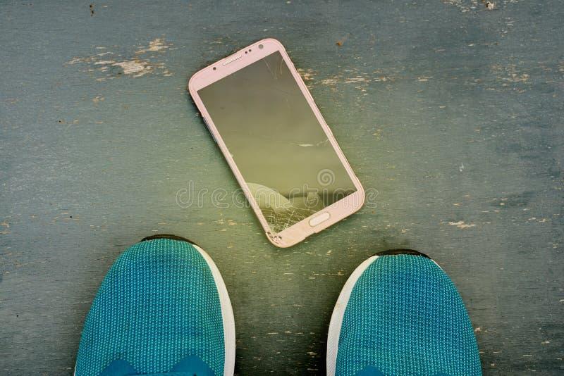 Mobile phone in screen broken. Smart phone in broken glasses royalty free stock photography