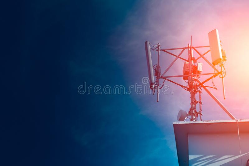 Mobile phone Signal tower cell site of Digital 4G. 5G system on roof top with space for text stock image