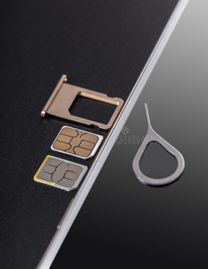 Mobile phone and sim card royalty free stock photos