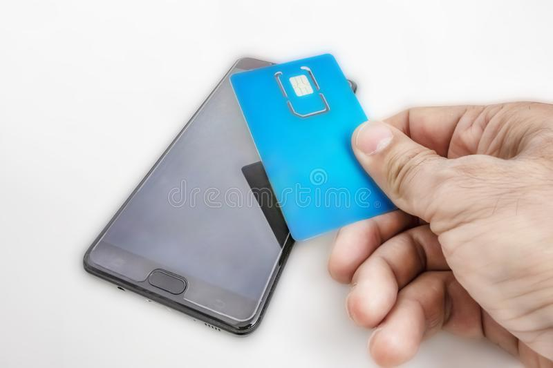 Mobile phone and sim card to communicate stock images
