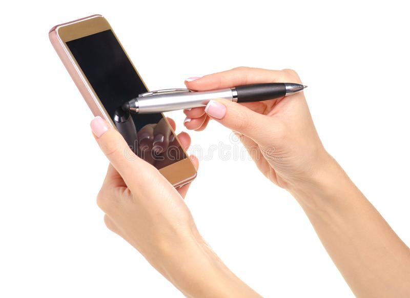 Mobile phone smartphone stylus pen in hand. On a white background isolation royalty free stock photo