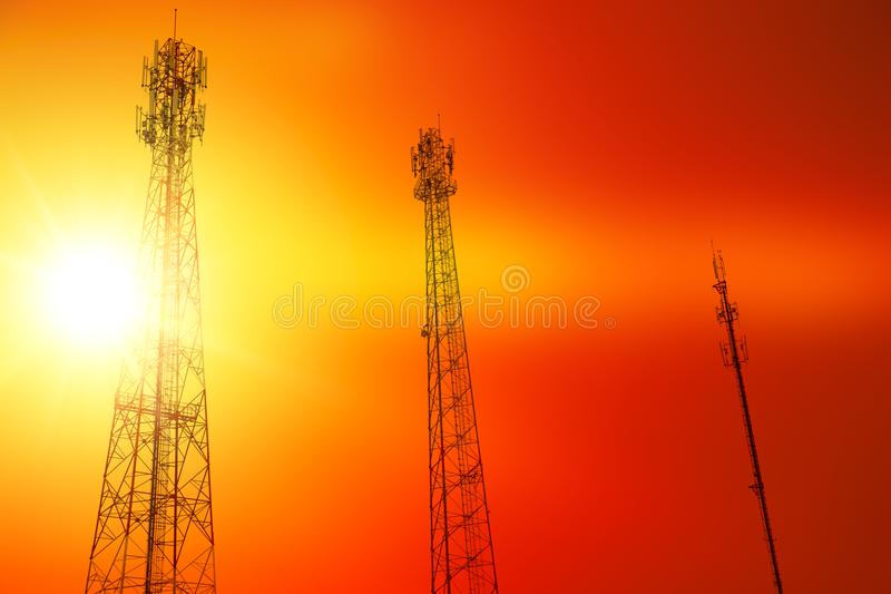 Smartphone telecommunication radio signal antenna tower silhouette with red hot sunset sky stock photo