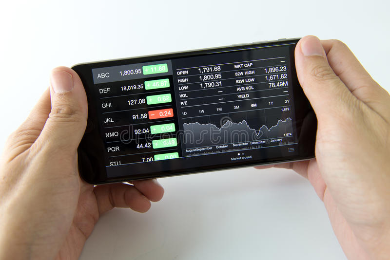 Mobile phone with stock market royalty free stock photography