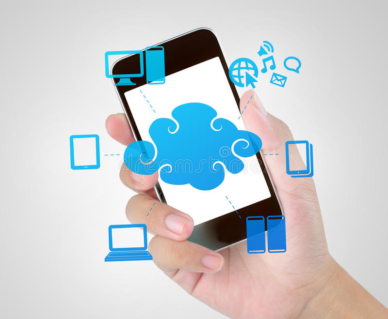 Mobile phone technology of cloud computing. Hand holding mobile phone technology of cloud computing royalty free stock photos