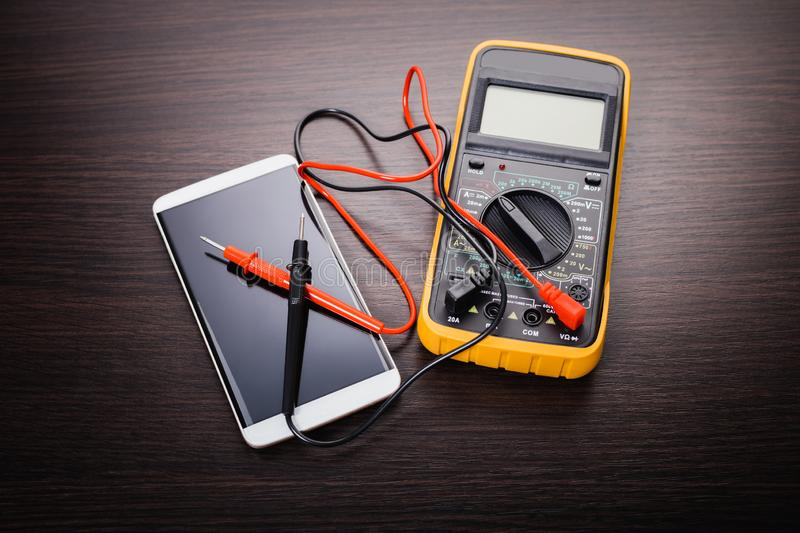 Mobile phone and tool stock photos