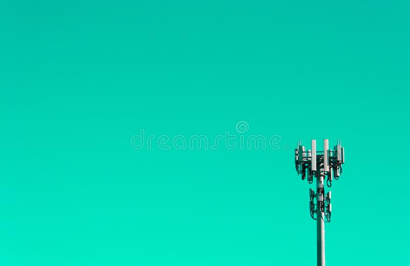Mobile phone tower against teal sky. Mobile phone tower placed against a teal sky/background for more dramatic effect stock photography
