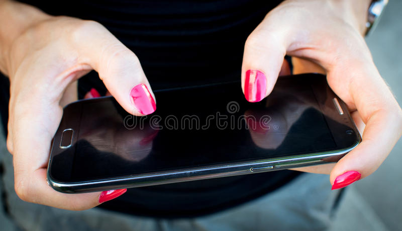 Download Mobile phone in woman hand stock image. Image of casual - 33066525