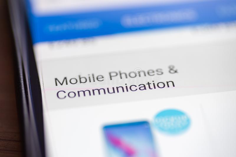 Mobile Phones and Communication category button link on shopping app on smartphone screen closeup.  stock images
