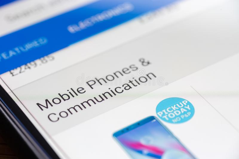 Mobile Phones and Communication category button link on shopping app on smartphone screen closeup.  royalty free stock image