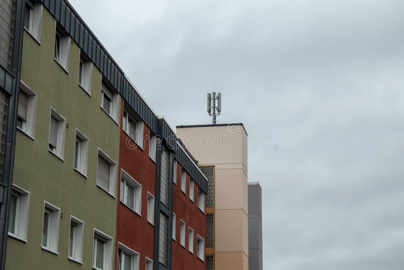 Mobile radio antennas on house roof Bergheim NRW Germany - 12 08 2019. Mobile radio antennas on house roof , cloudy sky, Bergheim NRW Germany - 12 08 2019 royalty free stock image