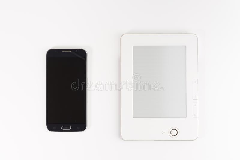 Mobile reading and literature library concept: book with blank screen and touchscreen smartphone isolated on white royalty free stock image
