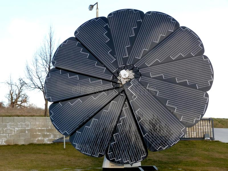 Sunflower shaped solar panel in spring time stock photo
