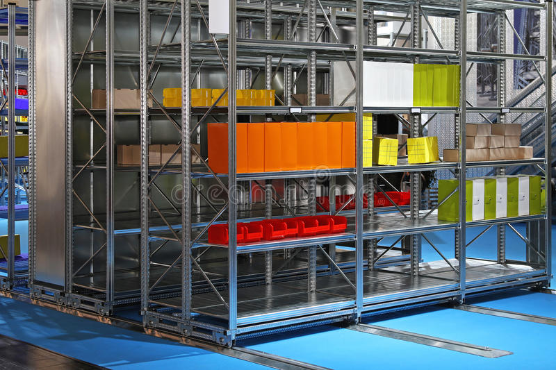 Mobile shelves storage. Mobile metal shelves storage system in warehouse royalty free stock photos