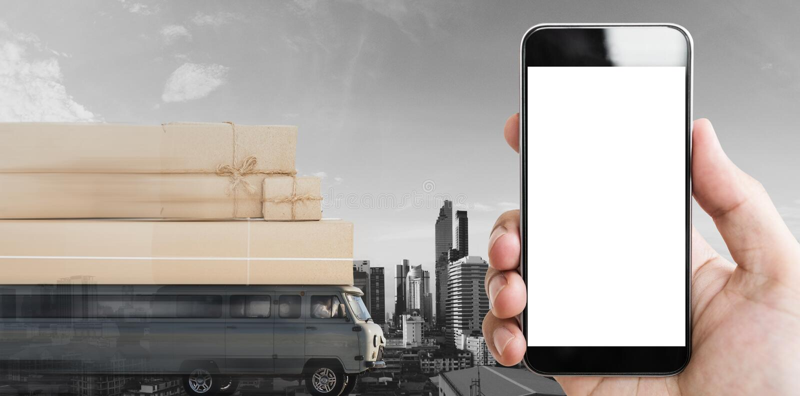 Mobile smart phone blank white screen, with delivery van with parcel boxes on roof driving fast. Online shopping and delivery serv royalty free stock photos