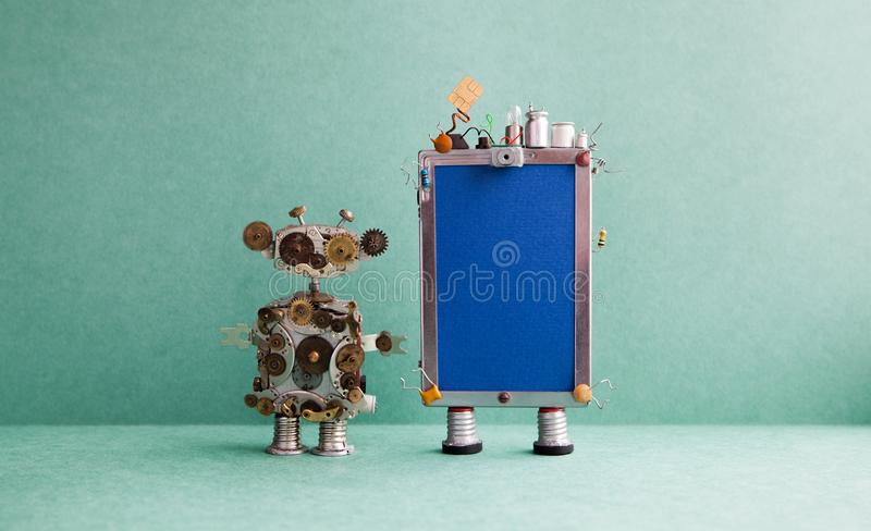 Mobile smartphone gadget and steampunk robot assistant. Funny robotic toy characters, creative design touch screen phone royalty free stock photography