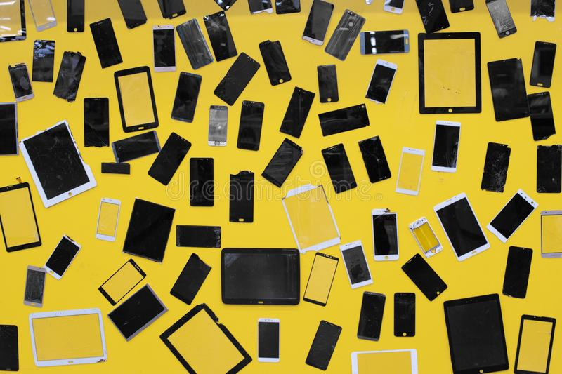 Mobile smartphone the tablet a lot of glass screen damage broken on yellow background royalty free stock images