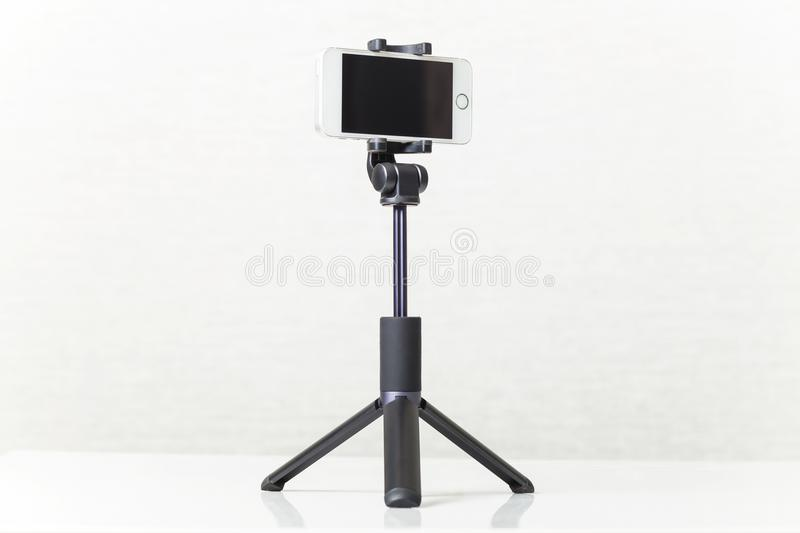 New smartphone on a tripod stock image
