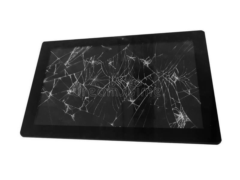 Mobile tablet device with a broken badly cracked shattered glass on the touch screen. Smart hardware part replacement concept royalty free stock photos