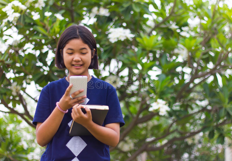 Mobile teen books. royalty free stock photography