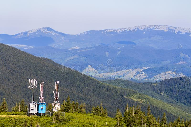 Mobile telecommunication tower or cell tower with antenna and electronic communications equipment in carpathian mountains stock photography