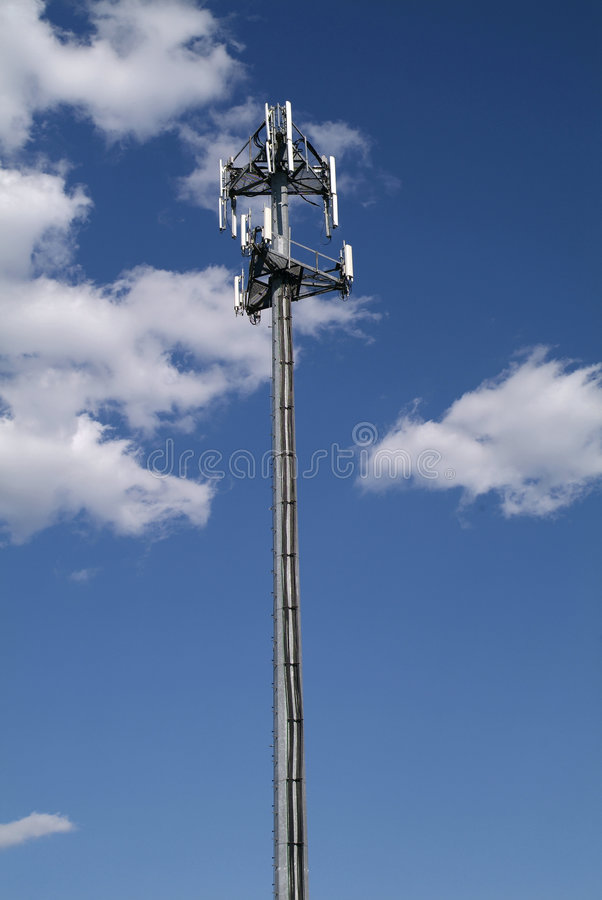 Mobile Telephone Cell tower. Cellular cellphone antenna repeater tower with blue sky and clouds stock images