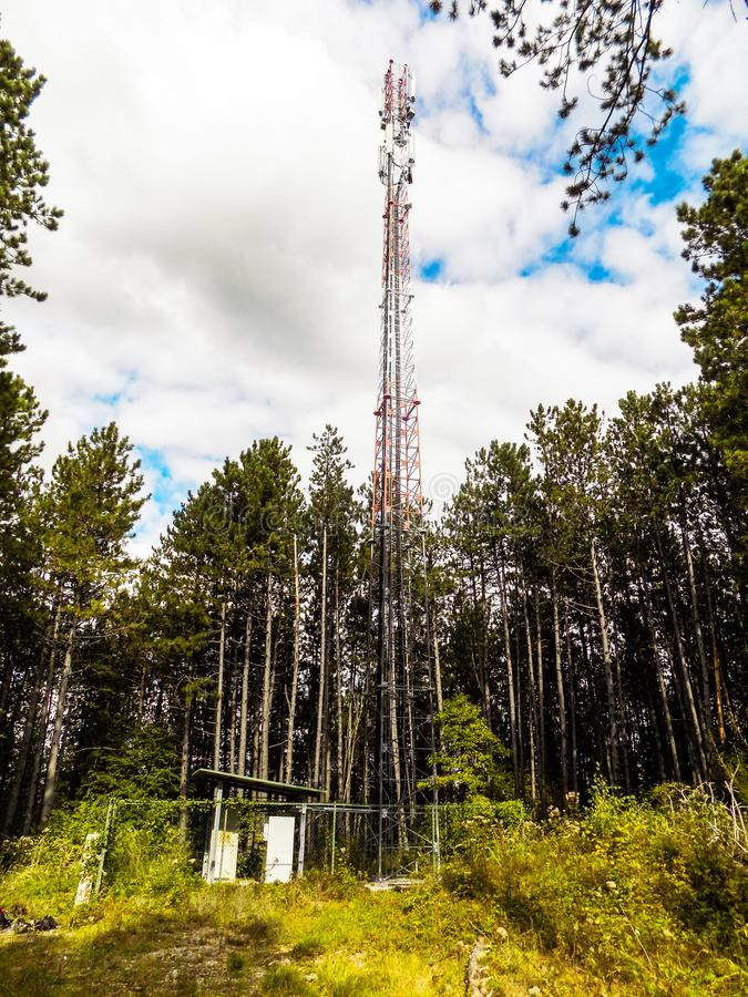 Telecommunication tower of mobile telephone network base station with smart cellular antennas radiating strong signal. Mobile telephone network base station stock photography