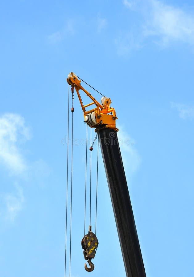 Mobile tower crane. Mobile construction tower crane against blue sky stock photo