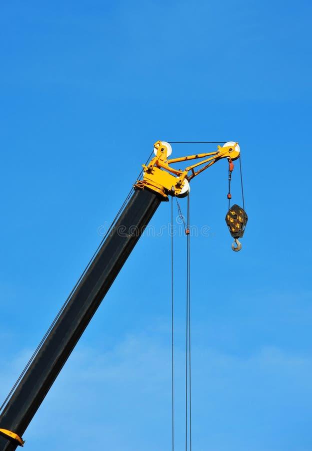 Mobile tower crane. Mobile construction tower crane against blue sky stock photos