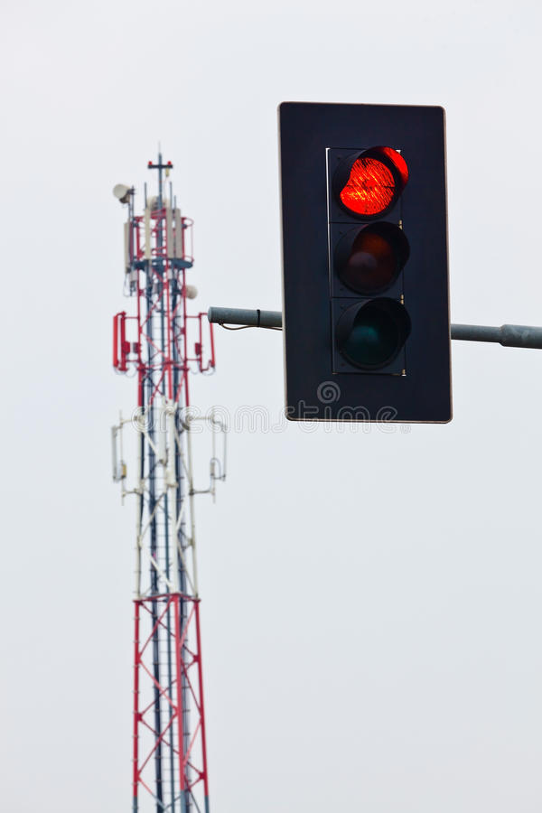 Mobile transmission tower and red traffic lights stock photography