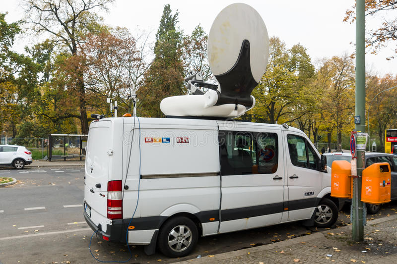 Mobile TV car of the German news broadcaster NTV. BERLIN - OCTOBER 30, 2015: Centre for the reception and registration of refugees - LaGeSo. Mobile TV car of royalty free stock photography
