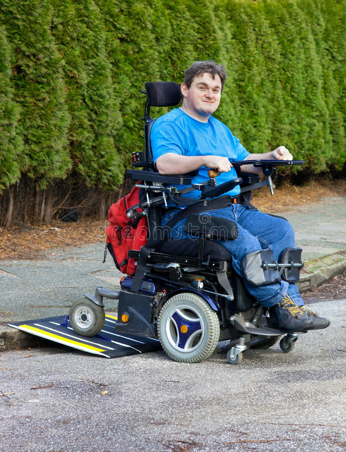 Mobility for infantile cerebral palsy patients. Mobility for infantile cerebral palsy patients caused by birth complications with a spastic young man in a stock images