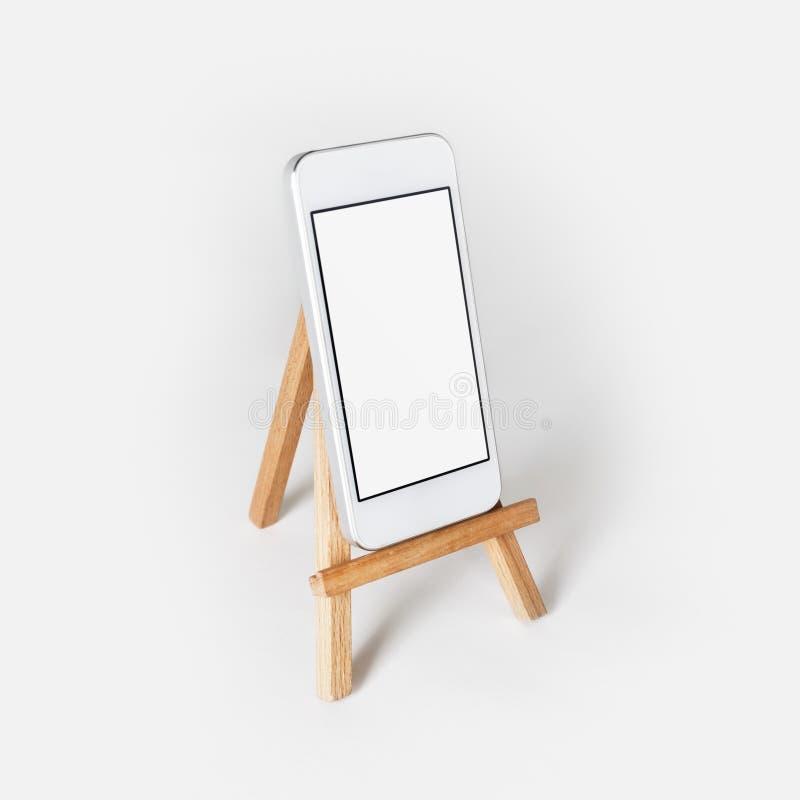 Mobiltelefon auf Halter stockfotos