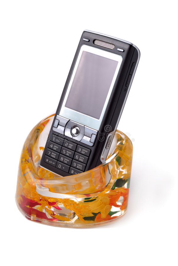 Mobiltelefon in der Halterung stockfotos