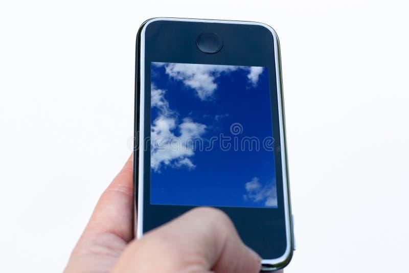 Mobiltelefon in der Hand lizenzfreie stockfotografie