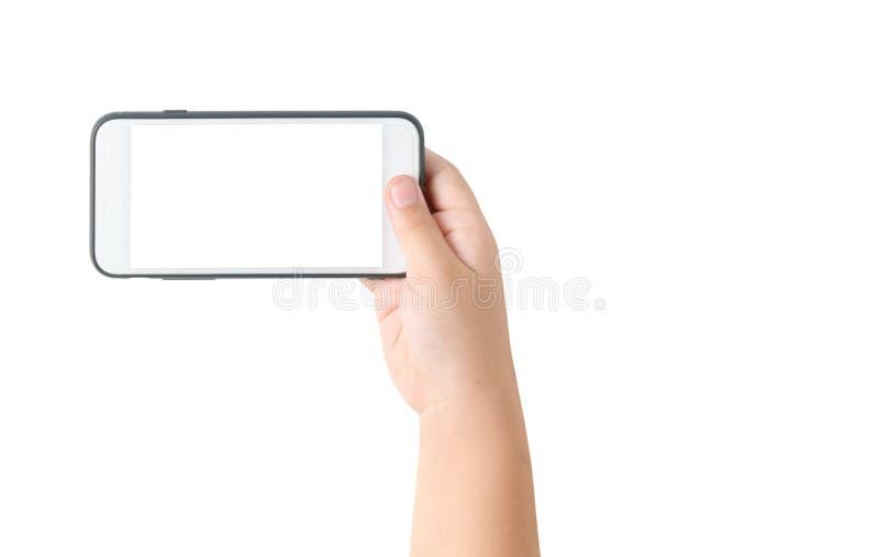 Mobiltelefon för barnhandhåll med den tomma vita skärmen fotografering för bildbyråer