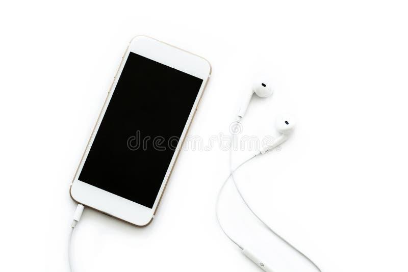 Mobiltelefon med headphonen royaltyfria foton