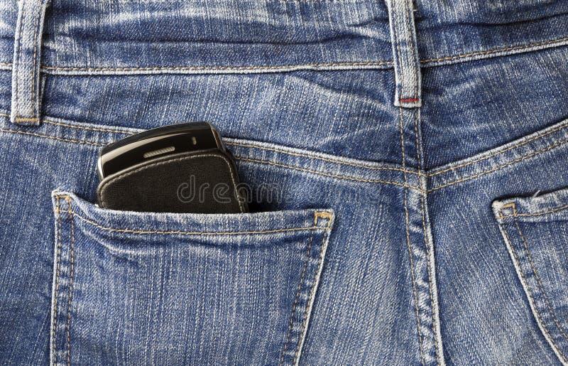 Mobiltelefon och jeans royaltyfria bilder