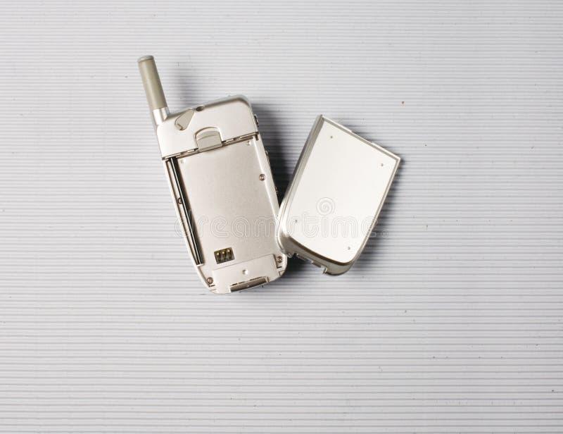 Mobiltelefon und Batterie stockbild